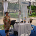 Caricature artist Ye Ruoshi standing at the Singapore museums night festival