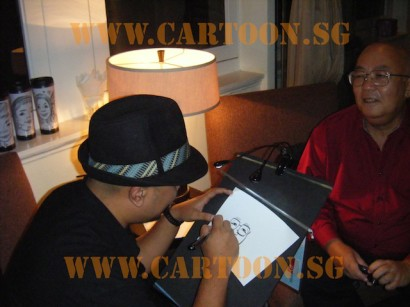 'Live' Drawing Caricature - Artist Kamal dollah @ work