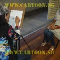 'Live' Caricature Drawing - Artist at work