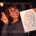 Lady holding a Caricature of herself