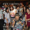 Professional caricature artist, Kamal Dollah surrounded by curious wedding guest