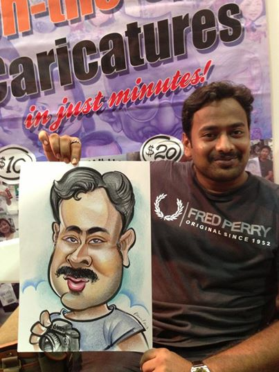 2013-09-02-Singapore-Caricature-artists-at-Comic-Con-STGCC-2013-drawing-Cameraman.jpg