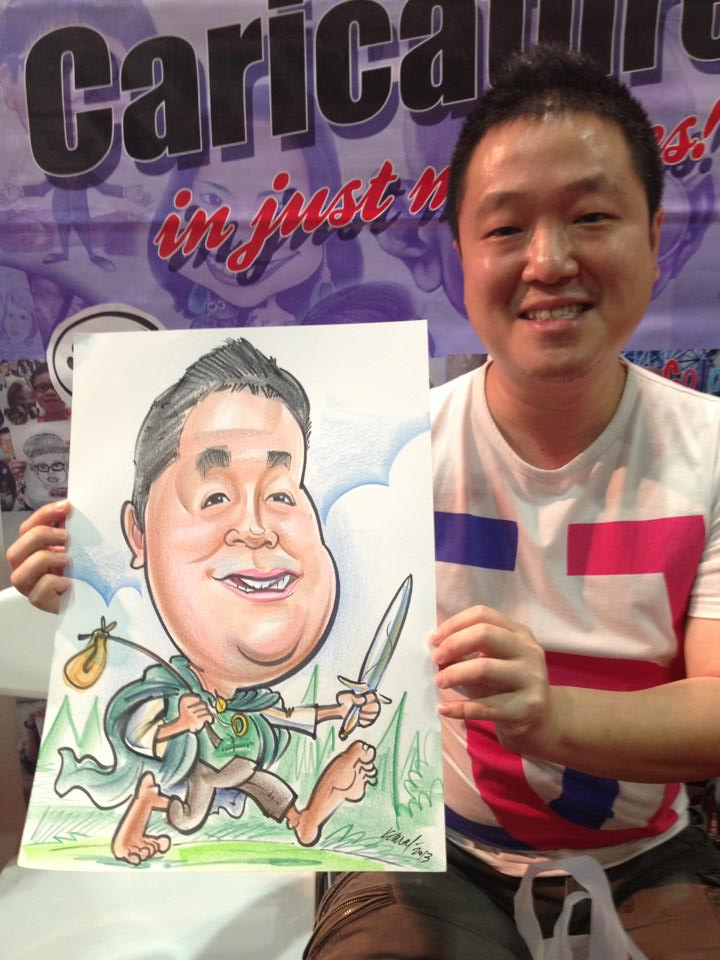 2013-09-02-Singapore-Caricature-artists-at-Comic-Con-STGCC-2013-drawing-Hobbit.jpg