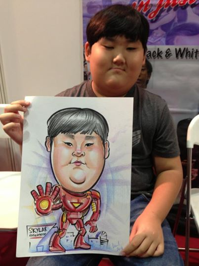 2013-09-02-Singapore-Caricature-artists-at-Comic-Con-STGCC-2013-drawing-Ironman.jpg