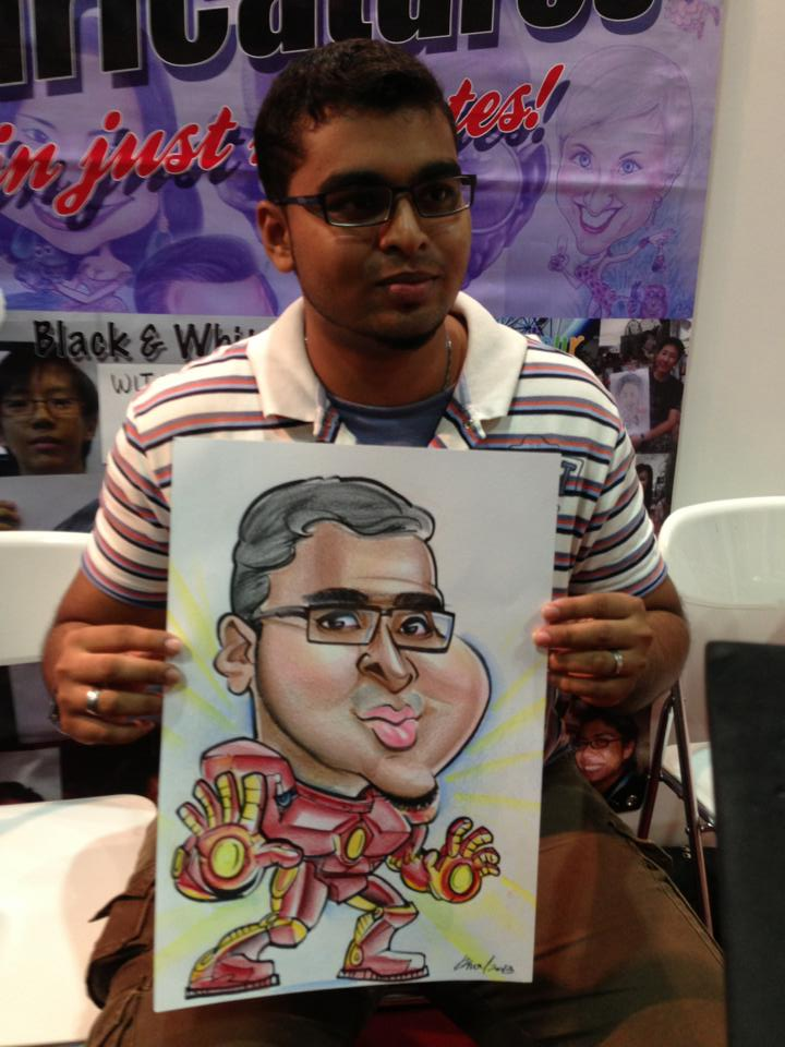 2013-09-02-Singapore-Caricature-artists-at-Comic-Con-STGCC-2013-drawing-Ironman2.jpg