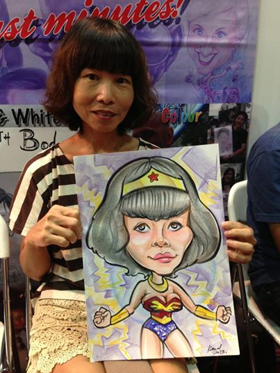 2013-09-02-Singapore-Caricature-artists-at-Comic-Con-STGCC-2013-drawing-Wonderwoman.jpg