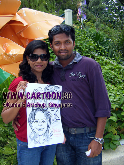 2011-03-04-Caricature-artist-in-Sentosa-live-drawing-couple.jpg