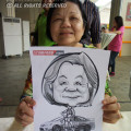 2014-04-27-Live-Caricature-Stamford-Tyres-aunty-with-her-drawing