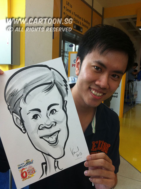 2013-01-13-popsicle-live-caricature-courts-megastore-event-guy-with-caricature.jpg