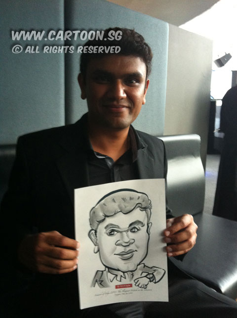 2013-01-16-live-caricature-event-guy-with-caricature.jpg