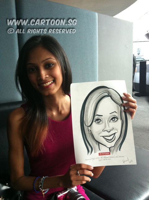2013-01-16-live-caricature-event-lady-with-drawing.jpg