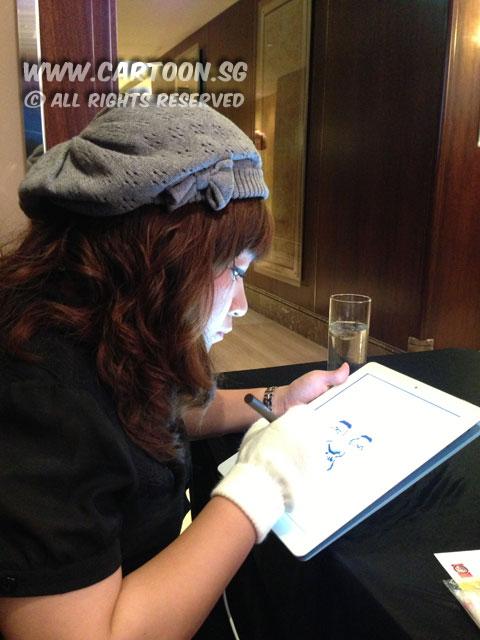 2013-02-19-digital-caricature-holiday-inn-artist-tablet.jpg