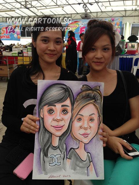 2013-06-02-muhammadiyah-caricature-event-two-girls-black-shirt.jpg