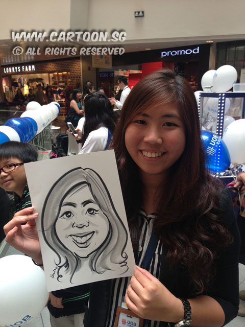 2013-06-29-UOB-roadshow-caricature-event-long-hair-girl.jpg